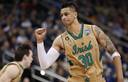 Notre Dame's Zach Auguste (30) celebrates after making a foul shot with time running down in the second half of an NCAA tournament second round college basketball game against Northeastern, Thursday, March 19, 2015, in Pittsburgh. Notre Dame won 69-65 to advance to the third round. (AP Photo/Gene J. Puskar)