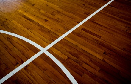 Close Up Of Wooden Floor Basketball Court